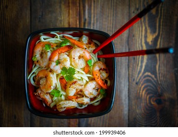 Pasta with grilled shrimps on wooden background