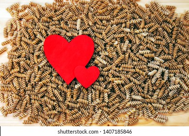 Pasta & healthy hearts - food concept and background texture for pasta recipes, healthy diets, cooking and loving wholewheat pasta - large file with design space.