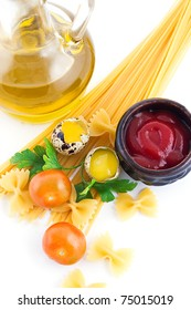 Pasta ingredients with cherry tomato, eggs, ketchup and greens