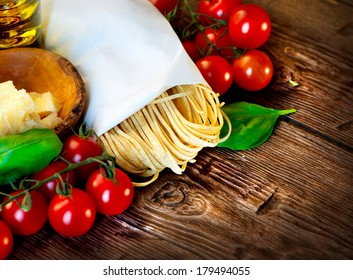 Pasta. Italian Homemade Spaghetti with truffles mushroom, cherry tomato, Parmesan cheese, basil and olive oil. Cooking Pasta. Dinner. Mediterranean cuisine