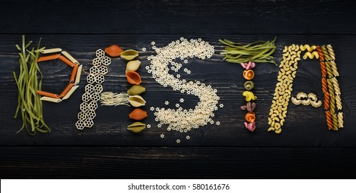 Pasta letters on a wooden background