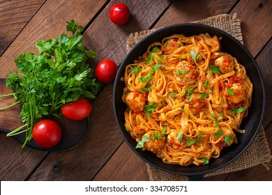 Pasta linguine with meatballs in tomato sauce. Top view
