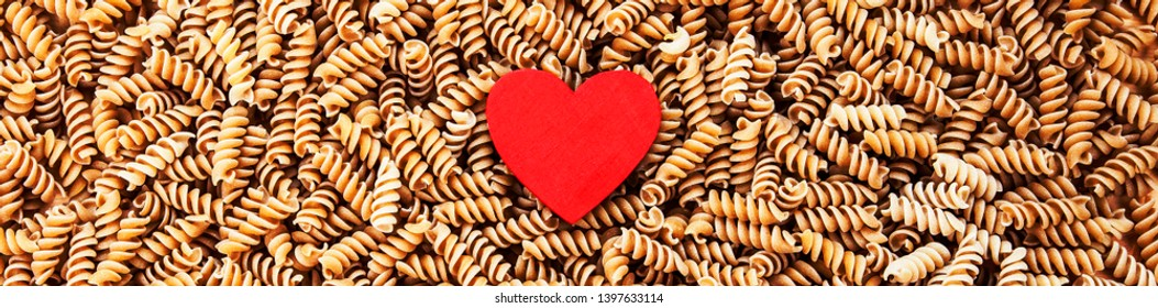 Pasta - love of pasta, & healthy heart food concept, for pasta recipes, diet, cooking and loving pasta - banner / panorama with design space.