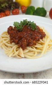 Pasta, macaroni and tomato sauce on a white dish are delicious. Put on a white wooden table.