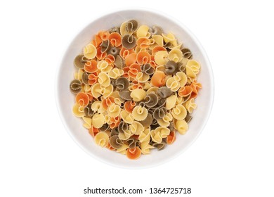 Pasta mushrooms in a white bowl. Isolated. Top view.