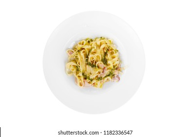 Pasta, noodles with bacon and sauce pesto, decorated with cheese. view from above. Serving a meal in a cafe, restaurant. Isolated white