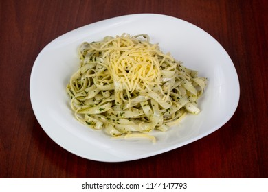 Pasta with pesto and parmesan cheese