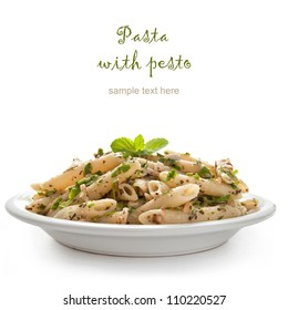 Pasta with pesto sauce, fresh basil and nuts on white plate