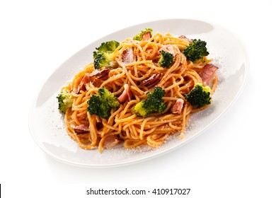 Pasta with pesto sauce, ham, Parmesan and broccoli