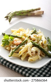 Pasta with prawns, asparagus and cream on complex background