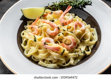 Pasta with prawns thyme and lime, fettuccine pasta. Italian food. recipe background. Close up.