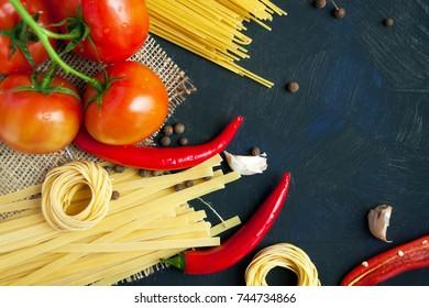 Pasta primavera. Fresh pasta and ingredients on a dark board. Pasta ingredients