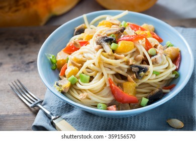 pasta with pumpkin, sweet pepper, mushrooms and peanuts