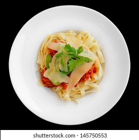 Pasta with rabbit meat and tomato sauce, isolated on black background