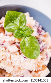 Pasta salad with cheese, ham, kidney beans and mayonnaise