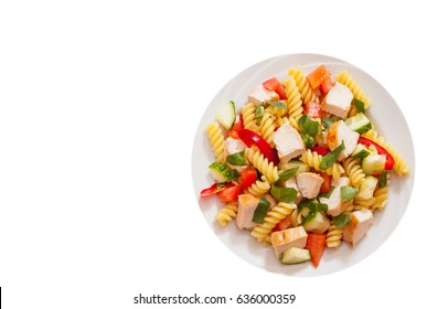 pasta salad with chicken and vegetables. top view. isolated on white