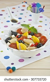 pasta salad colors tomato olives pepper cheese oil