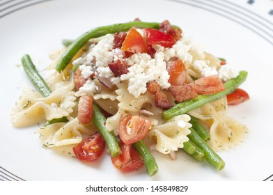 Pasta salad with green beans.onions and feta cheese