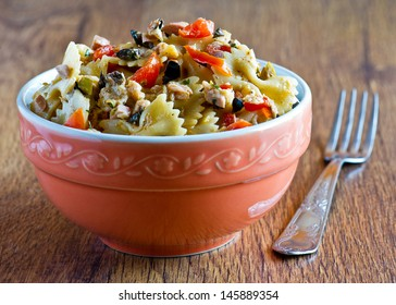 pasta with salad and red tomatoes