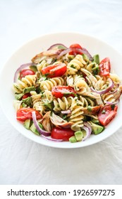 Pasta salad with tomato, avocado, chiken and red onions