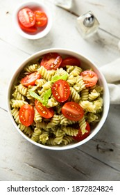 Pasta salad with tomato and pesto