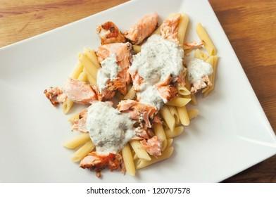 Pasta with salmon and basil sauce