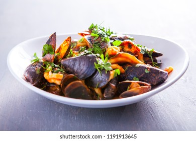 Pasta with seafood. Pasta with mussels and basil. Fresh Seafood fresh homemade pasta with mussels and parsley. Fresh Italian food. Mediterranean fresh sea food dish. Beautiful plate. fine dish