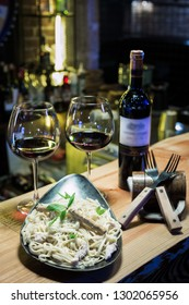 Pasta served with red wine at bar counter