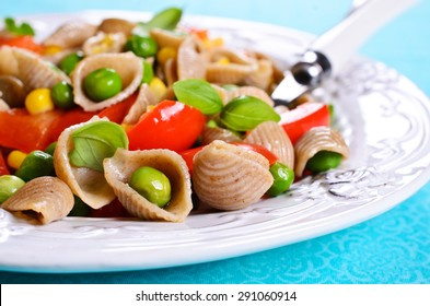 Pasta in the shape of seashells from rye flour with vegetables