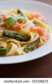 Pasta with shrimps and asparagus. Shallow DOF