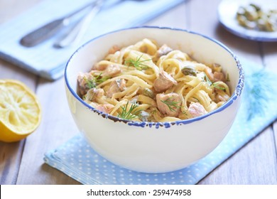 Pasta with smoked salmon and capers in cream sauce, italian cuisine