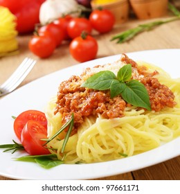 Pasta spaghetti with bolognese beef tomato sauce basil and parmesan