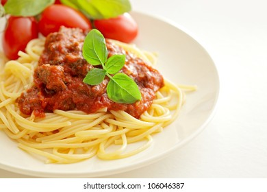 Pasta spaghetti with bolognese sauce and basil