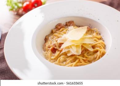 Pasta spaghetti carbonara on white background. Top view