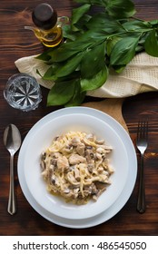 Pasta spaghetti with chicken and mushrooms, top view