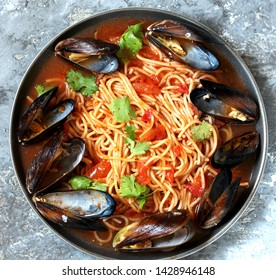 Pasta Spaghetti with mussels, tomato sauce. sea food meal. Mussels Marinara. Typical dish of Italian pasta.  top view.