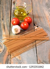 Pasta and spaghetti sauce ingredients on rustic wood table