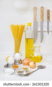 pasta, spices and healthy food on the kitchen table