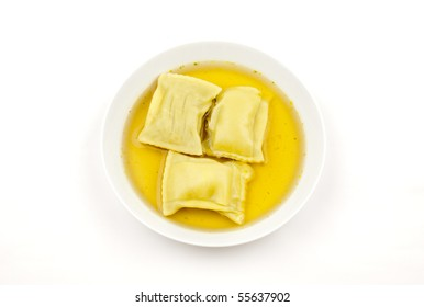 Pasta squares in clear soup, isolated on white background