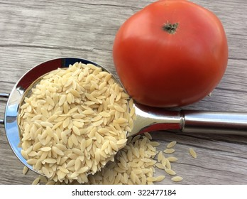 Pasta in strainer with tomato