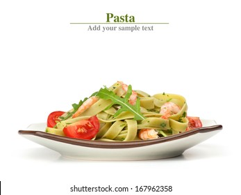 Pasta tagliatelle with shrimp and arugula