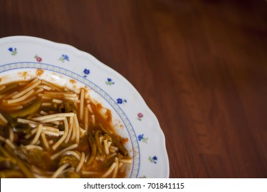 Pasta with tenerumi summer soup, typical dish of traditional Sicilian cuisin, made by the most tender leaves of zucchini long. Blured image, copyspace, selective focus.