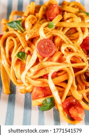 Pasta with tomato sauce and basil. Close-up of traditional italian food