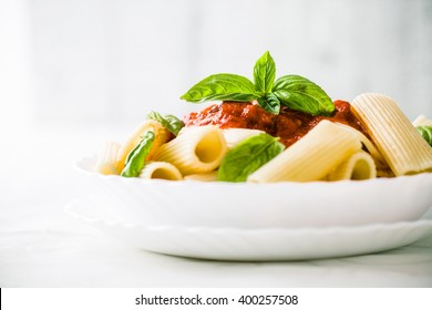 Pasta with Tomato Sauce and Basil. Italian food. Mediterranean cuisine