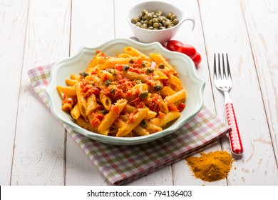 pasta with tomatoes capers and tumeric