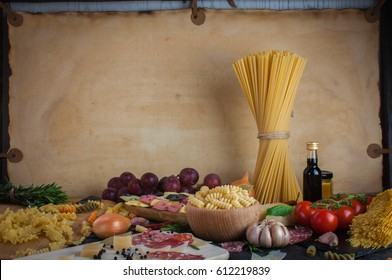 Pasta,  tomatoes, salami and cheese on the table