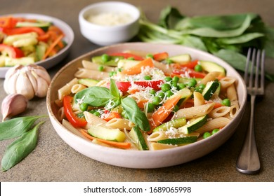 Pasta with zucchini, carrots, red bell pepper, garlic and parmesan. Primavera Traditional Italian Vegetable Pasta