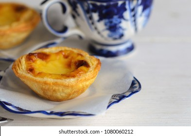 Pasteis de Belem, l Portuguese egg tart pastries with coffee at Lisbon cafe,Portugal. Pastel de nata sweets making using traditional methods and according to the Jeronimos Monastery secret recipe.