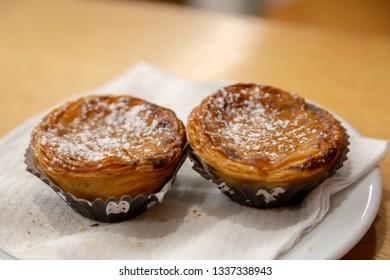 Pasteis de Nata, Portuguese custard tarts on a plate.