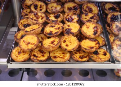 Pasteis de nata - traditional Portugese cuisine egg tarts with creamy filling.